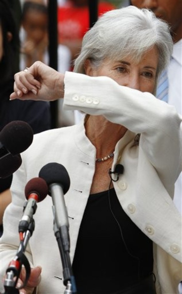 Secretary Sebelius Coughs into her Sleeve