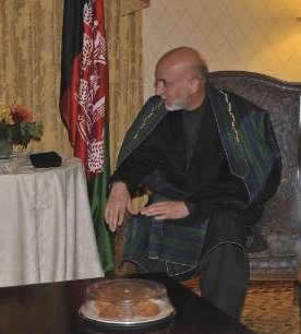 Go Long Karzai Chilling